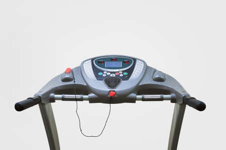 An exercise treadmill on a plain background. Isolated on white background. Treadmill front view in the first person.