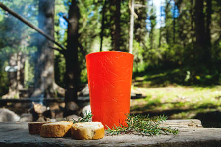 Sip coffee in a glass, grill and barbecue. Romantic atmosphere. Relaxing time camping on a mountain. Activity in holiday concept. Close up.