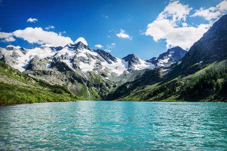 Beautiful mountain lake with turquoise Multinskoe Chita clear water in the Altai Republic Siberia Russia