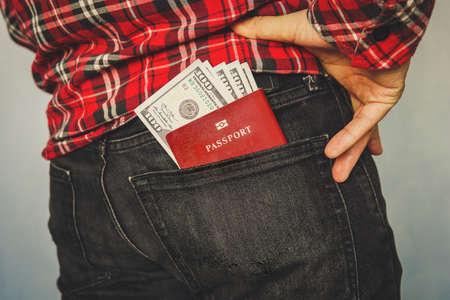 red passport in a pocket of jeans Banco de Imagens