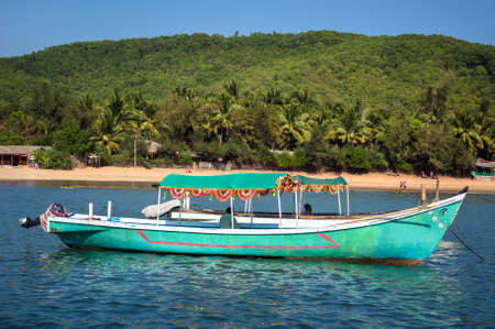 Indian boat in the Sea on the beach background. Gokarna India