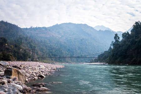 bridge in the vicinity of Rishikesh India. Suspension bridge over river. Long rope bridge cross the stream in the village