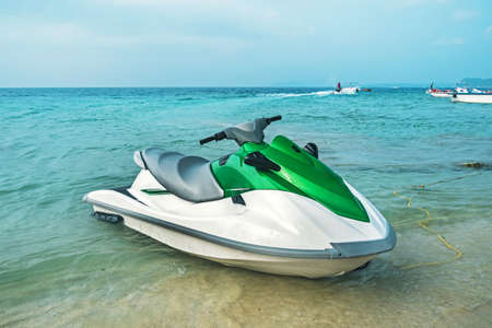 Jet ski on the beach. jet, ski, water motorcycle. the concept of marine entertainment in the summer at the seaside resort