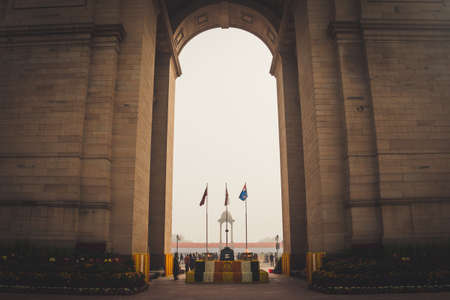 New Delhi, India, January 27, 2018 : Canopy and India Gate. Air Force, Indian Navy and Indian Army Flags Waving at India gate. The Indian gate is the national monument of India. Republic day.