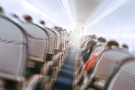 aerophobias concept. plane shakes during turbulence flying air hole. Blur image commercial plane moving fast downwards. Fear of flying. collapse slump, depression, downfall, debacle, subsidence, trip.
