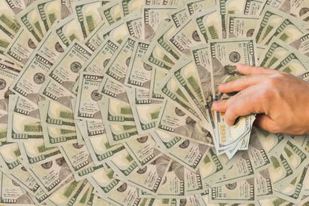 a million dollars in the hands of men. big win in the casino. man is holding money. Background of dollars closeup. millionaire, billionaire, benefit, prize, winner
