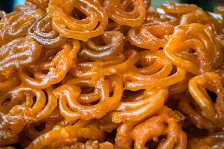jalebi Indian sweet dish. traditional Indian sweets fried in boiling oil. Stock Photo