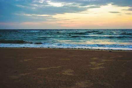Early Morning Sunrise on Waimanalo Beach on Oahu, Hawaii bursting through the clouds.