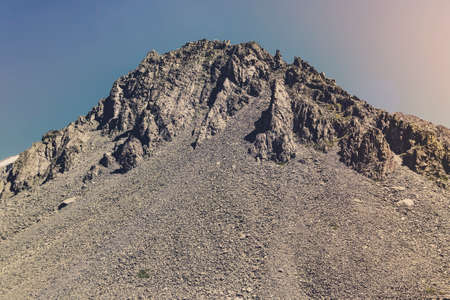 High top of the mountain with the stone loose. Dangerous rockfall or landslide. Stone placer