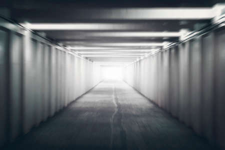 The Light at the End of the Tunnel. Pedestrian crossing under the road. underground passage. motion blur. concept of hope, or the afterlife. after death, next world