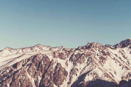 snow-covered mountain range is toned in retro style. ski resort Shymbulak, Medeo Almaty, Kazakhstan Stock Photo