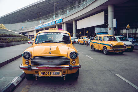 Vintage yellow taxi in the airport Parking lot. KOLKATA, INDIA - 26 January 2018 Redakční
