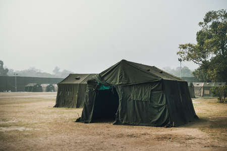 the Army military camp in the forest, nobody, anywhere in the world. a refugee camp on the border. Field of the barracks. Military field medicine. Field hospital. Pow camp. army base, installation Фото со стока - 109035043