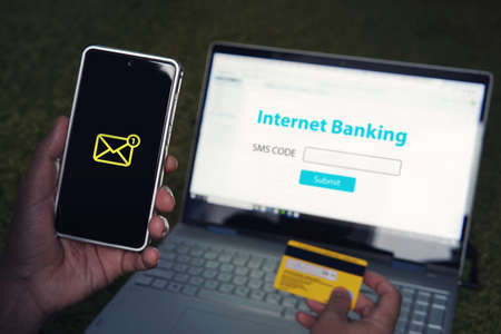 Internet Banking Online Payment Technology Concept. Came SMS password from your personal account mobile phone to enter the online Bank. online banking is protected by an individual password