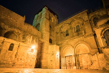 main entrance of Holy Sepulchre Cathedral and the courtyard in front of the temple at night. Jerusalem, Israel.