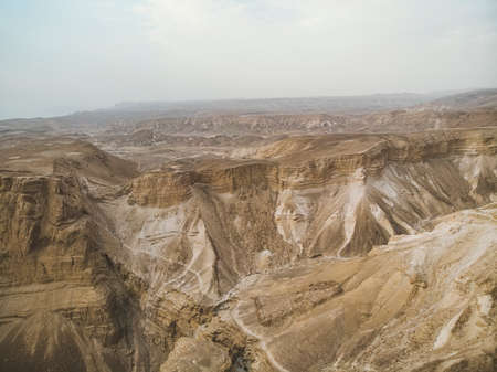 Canyon in the Judean Desert , Midbar Yehuda, on the dead sea, Israel. Background of lifeless land in the desert on the West Bank of the Jordan river