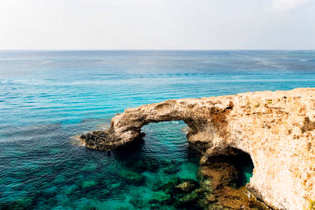Bridge of Lovers rock formation on the rocky shore of the Mediterranean sea on the island of Cyprus Ayia NAPA. No people