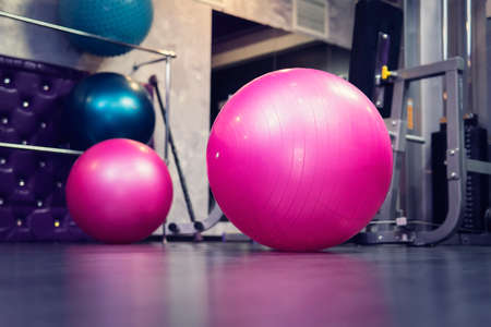 Fitness ball in the health club, Exercise by gyms pink ball.