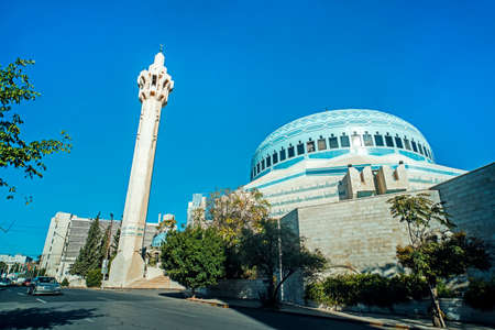 King Abdullah I Mosque in Amman, Jordan. It was built between 1982 and 1989. modern mosque. The tall minaret on the background of blue sky.