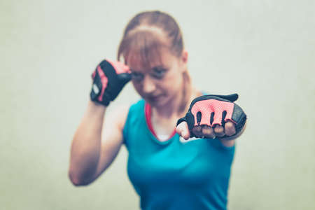 threatened with fists. close unarmed. Fist in the foreground. Girl practicing hand-to-hand combat