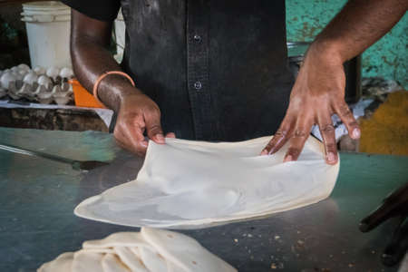 Making of Roti Canai, Roti cooking process, roti fried indian food. pancake, tortilla, flat Imagens