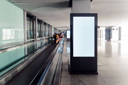 blank advertising billboard at airport,Mock up Poster media template Ads display in Subway station escalator. people on a direct escalator at the airport or store