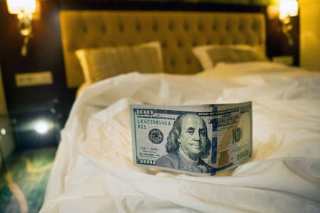 A tip on the bed. a hundred dollars under the blanket. payment for the services of prostitutes.