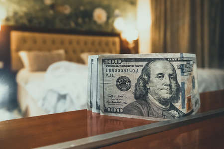 room tip. bed and money to symbolize the cost of sex. Paid love the prostitute. Payment for the services of prostitutes. A tip for the staff.