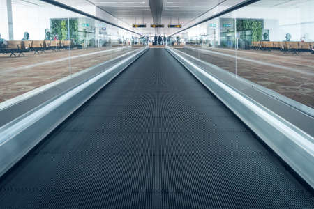 Escalators in airport. escalator, interior of the Indian pudong airport.