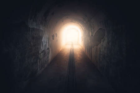 Light in end of tunnel. Long underground concrete corridor in abandoned bunker, toned. Tunnel in underground protective bunker. Protection against nuclear attack.