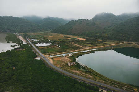Top view of the wetlands of the island of Cat BA near the sea on land. Morning gloomy landscape of the countryside of Vietnam.