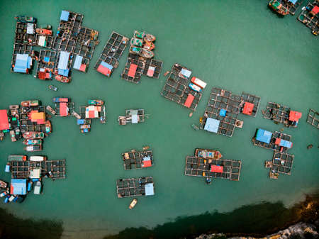 a floating fisherman's village in ha long bay, northern vietnam. top view, aerial view,