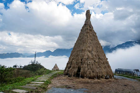 Traditional home of small peoples of North Vietnam, living in the mountains near the city of Sapa. Historical reconstruction. Installation. Ancient straw dwelling tribes in Southeast Asia.