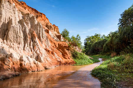 beautiful creek fairies with red and white sandstone in Mui Ne, Vietnam. The river flows in the canyon. Beautiful landscape of unique natural attractions of Southeast Asia 版權商用圖片