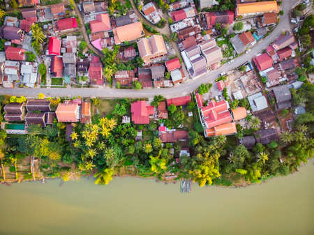 Top view of Luang Prabang, Laos. Aerial view of the red roofs of houses. Stock Photo