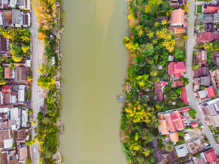 Top view of the red roofs of the city and the green river Luang Prabang Laos. 版權商用圖片