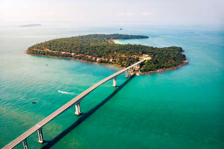 Long road and pedestrian bridge TECHO MORAKAT to Snake island KOH PUOS. Sihanoukville. Cambodia. Top view aerial view.