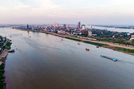 Phnom Penh city skyline and Tonle Sap River. Phnom Penh is capital and largest city in Cambodia. Top aerial view