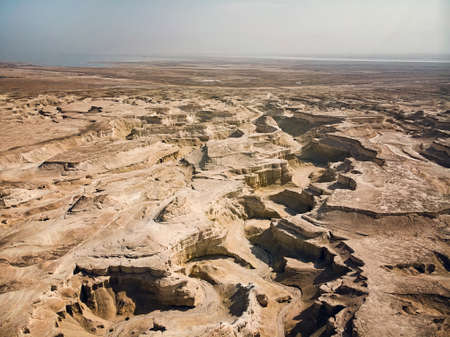 Canyon in the Judean Desert. Aerial view of the Judean desert located on the West Bank of the Jordan river. Deserted shore of dead sea. The background of desert. Stony canyon in the desert