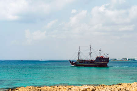 Tourists are swimming in the sea near the pirate ship Black Pearl , Cavo Greco, Cyprus. Editorial
