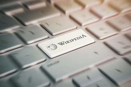 button with the company logo Wikipedia on the grey keyboard of a modern laptop. Редакционное