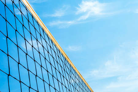 yellow colored summer games ball background - beach volleyball or tennis net against blue sky for sport events. copyspace. copy space Foto de archivo - 127867470