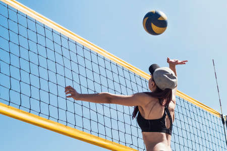 young girl playing beach volleyball. sports games. Beach volley ball match. Outdoor sports activities, vacation fun time. Foto de archivo - 127867892