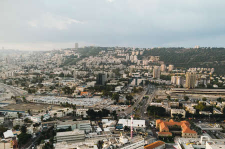 Aerial View of Haifa city, Israel. Scenic panorama of metropolitan area of Haifa. City located on Mount Carmel, view on a sunny fine day. Architecture and infrastructure of Haifa.
