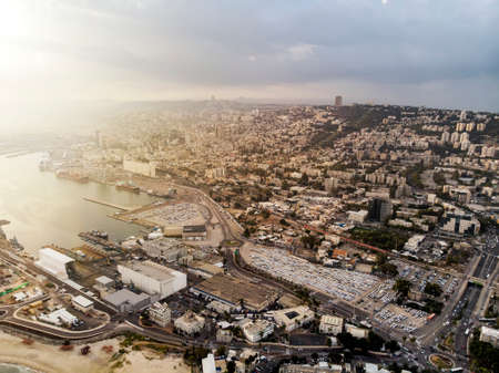 Haifa city and harbor. Panoramic view of Haifa city and harbor, Mediterranean Sea, Israel. Sunlit shot of Haifa port from above. Scenic view on Haifa and Carmel Mount from drone. A seaside city Banque d'images - 127868174