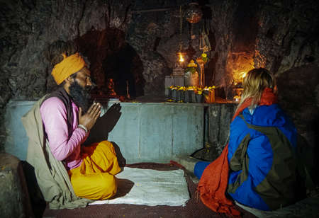 Babba, a Holy man in India, a mentor of believers, prays for his disciples in a sacred cave in front of the statues of Indian gods. Sajtókép