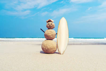 Snowman in the sand on the beach