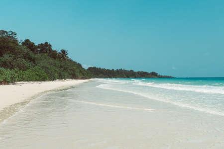 White clean sand on the beach of a desert island.