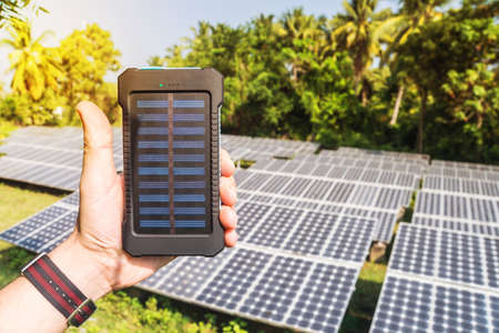 Mobile phone charging solar power used Stockfoto