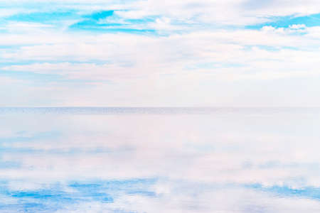 Beautiful mirror reflection on blue sky and cloud. Water reflection of clouds and empty space. Holiday, vacation, freedom scene with horizon. beautiful calm landscape. Ecologically clean place Foto de archivo - 131278990